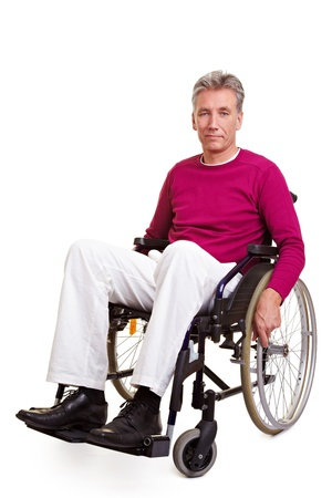 disabled person: Elderly handicapped man sitting in a wheelchair Stock Photo
