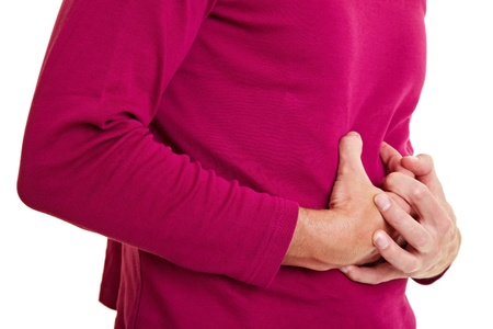 intestino: Hombre con bellyache, manteniendo su est�mago dolorido Foto de archivo