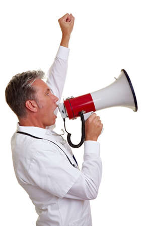 demonstrate: Senior physician protesting with clenched fist and a megaphone