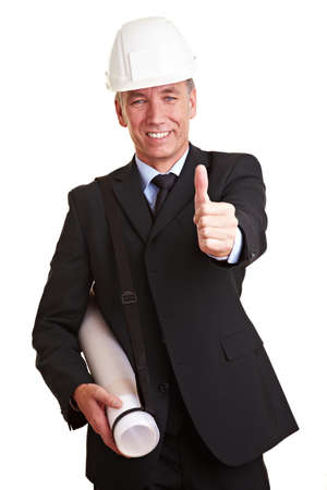 Happy architect with helmet holding his thumb up photo