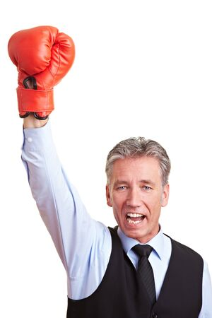 Sucessful manager cheering with a red boxing glove photo