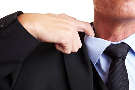 overwhelmed: Business man loosens his shirt with his index finger