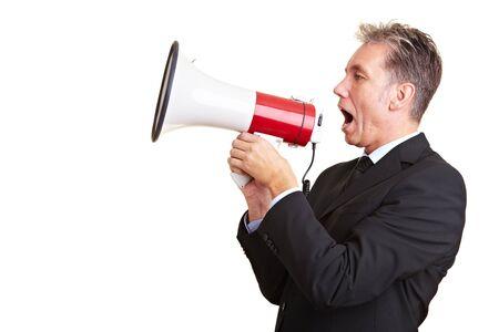 speaking tube: Elderly business man screaming loudly in a megaphone