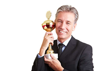 Happy senior business man holding a trophy in his hands Stock Photo - 8903787