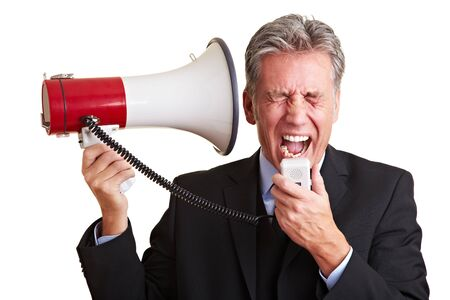 Elderly business man screaming loudly in a megaphone photo
