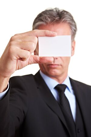 Manager holding white business card in front of his face photo