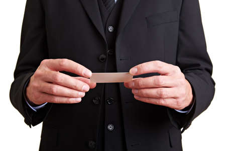 Hands in a business suit holding a business card respectfully photo