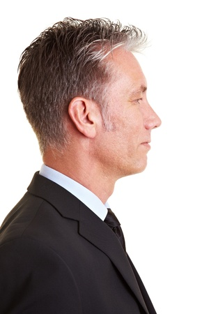 looking sideways: Side view of an elderly business man