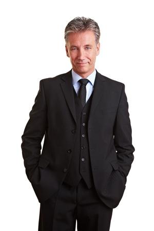 frontal portrait: Content senior business man smiling in a suit
