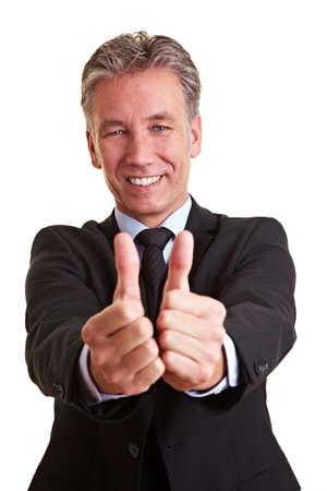 Happy elderly business man holding both his thumbs up photo
