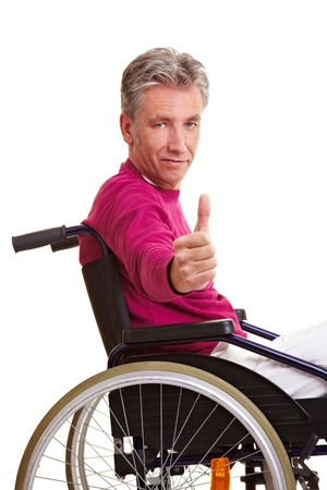 cutout old people: Elderly disabled man in wheelchair holding thumbs up Stock Photo