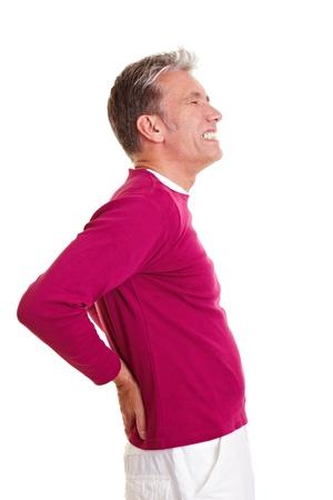 lean back: Senior man with back pain holding his aching back