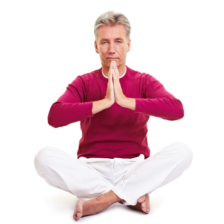 Relaxed senior man folding his hands for a prayer Stock Photo - 8953269