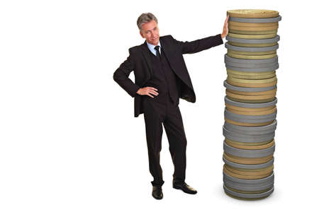 Senior business man leaning an a huge stack of Euro coins Imagens - 8988328