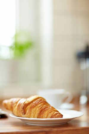 Delicious croissant in the morning on a kitchen counter photo