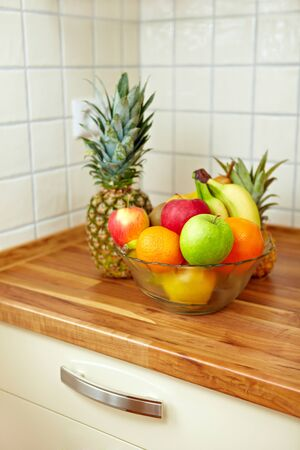 Colorful fruit bowl on a kitchen counter photo
