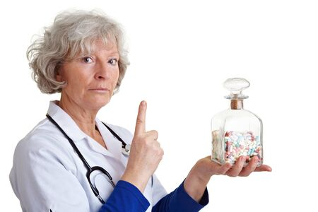 admonish: Elderly doctor warning with index finger and many pills