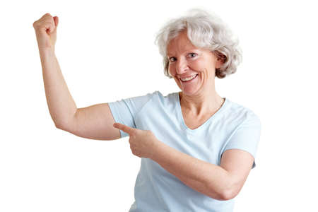 Elderly happy senior woman doing fitness exercises and showing her muscles Stock Photo - 9108634