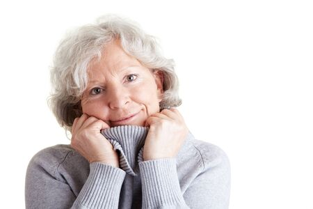 cutout old people: Happy elderly woman with warm turtleneck sweater in winter Stock Photo