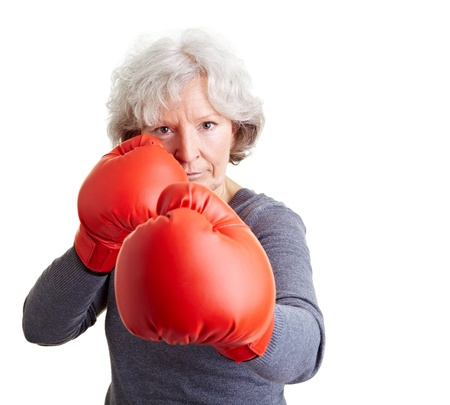 woman boxing gloves: Active elderly woman fighting with red boxing gloves Stock Photo
