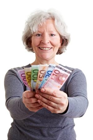 Happy senior woman holding many Euro banknotes photo