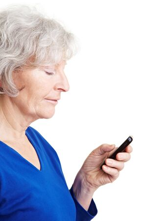 Happy senior woman reading text message on her mobile phone