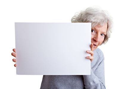 shot from behind: Shy senior woman holding a white poster Stock Photo