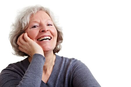 Happy old senior woman with grey hair laughing photo