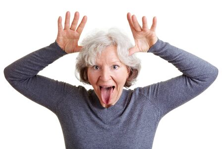 Silly old senior woman showing her tongue and making a face Stock Photo - 9114954
