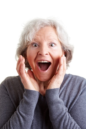 women face stare: Surprised elderly woman with grey hair looking happy