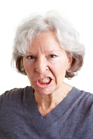 bare women: Angry old senior woman showing her teeth Stock Photo