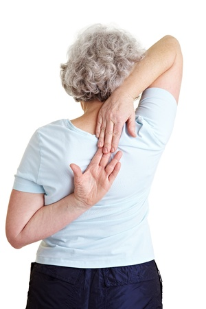 woman back of head: Elderly woman touching her hands behind her back