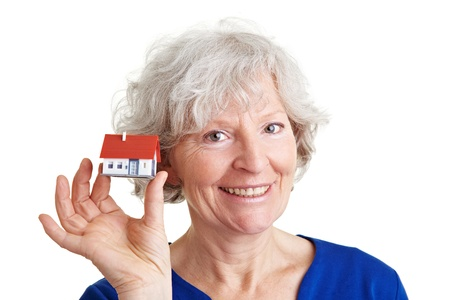 scheduling: Happy smiling elderly woman selling real estate Stock Photo
