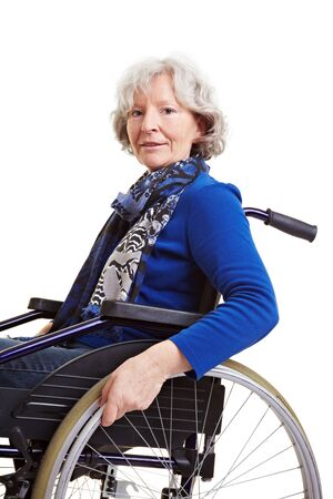 Handicapped elderly woman sitting in a wheelchair photo
