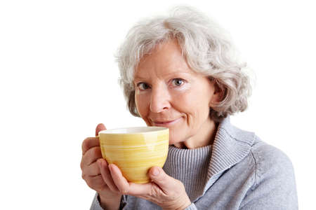Smiling senior woman drinking a big cup of coffee photo