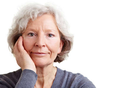 citizen: Serious senior woman looking into the camera Stock Photo