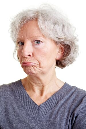 grimacing: Old senior woman grimacing with her face
