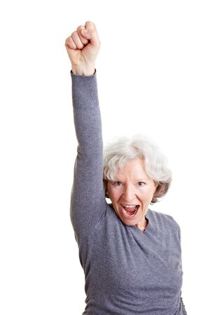 cheer: Cheering old senior woman clenching her fist Stock Photo