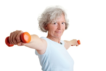 Strong elderly woman using dumbbells for strength training photo