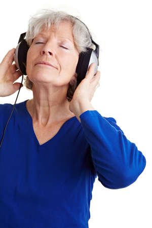 Relaxed senior woman listening to music with headphones Stock Photo - 9115165