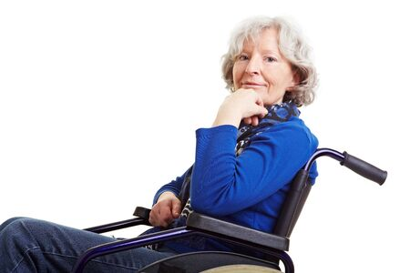 mobility nursing: Disabled old senior woman sitting in a wheelchair