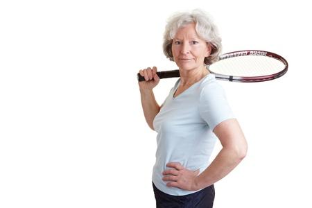 Happy senior woman with a tennis racket photo