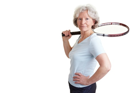 Happy senior woman with a tennis racket photo