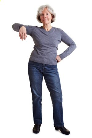 Old senior woman leaning on an imaginary object photo