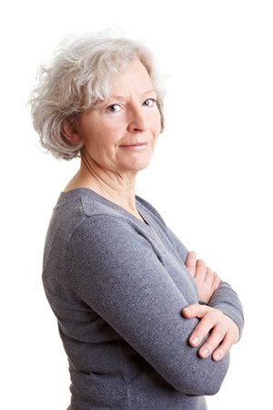 Smiling old senior woman with her arms crossed photo