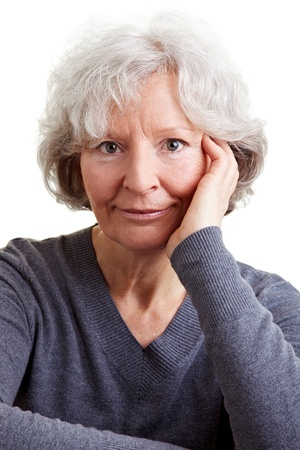 Portrait of a smiling elderly woman with her head on her hand Stock Photo - 9115045