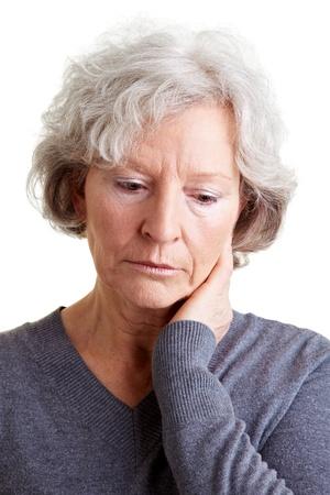 Sad old senior woman looking down and crying photo