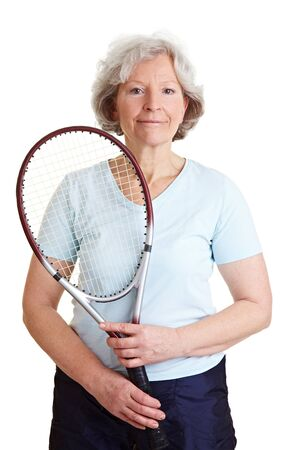 tennis racket: Smiling elderly woman holding a tennis racket Stock Photo