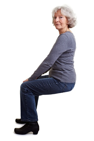 stool: Old senior woman sitting on an imaginary chair or stool