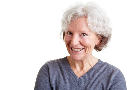 Funny senior woman with a grin on her face photo